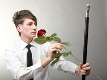 Portrait young man and rose enamoured love Stock Photos