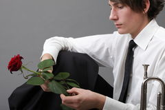 Portrait young man and rose enamoured love Stock Photography