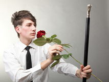 Portrait young man and rose enamoured love Royalty Free Stock Images