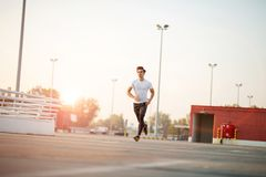 Young man running in urban area royalty free stock photography