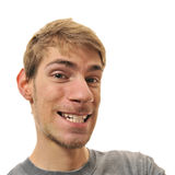 Portrait of young man's distorted. Portrait of young man making a funny face isolated on white Royalty Free Stock Image