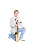 Portrait of a young man with a saxophone Stock Photos