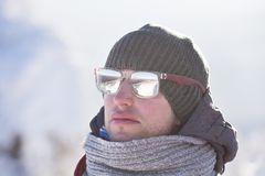 Portrait of a young man in a scarf. Cold winter stock photo
