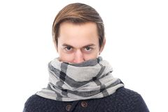 Portrait of a young man with scarf covering face Stock Photos