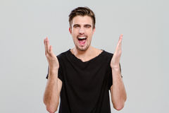 Portrait of young man screaming with hands up Royalty Free Stock Photos