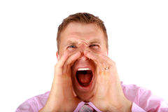 Portrait of a young man screaming out loud. Closeup portrait of a young man screaming out loud on a white background stock photo
