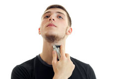 Portrait of young man shaving his beard Stock Photos
