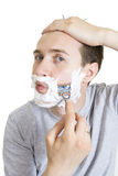 Portrait of young  man shaving isolated Stock Photography