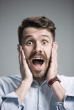 Portrait of young man with shocked facial expression Stock Photos