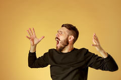 Portrait of young man with shocked facial expression Royalty Free Stock Photos