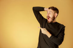 Portrait of young man with shocked facial expression Stock Image