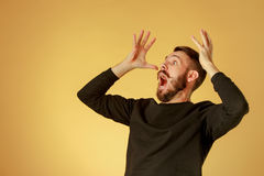 Portrait of young man with shocked facial expression Stock Photo