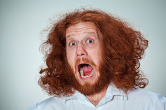 Portrait of young man with shocked facial expression Royalty Free Stock Image