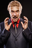 Portrait of young man shouting. Portrait of furious young man shouting on a black background Stock Photo