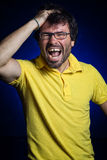 Portrait of young man shouting. Studio portrait of young man shouting to the camera Stock Photos