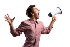 Portrait of a young man shouting using megaphone. Isolated on white Royalty Free Stock Image