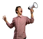 Portrait of a young man shouting using megaphone. Isolated on white Stock Photo