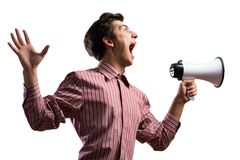 Portrait of a young man shouting using megaphone. Isolated on white background Royalty Free Stock Photo