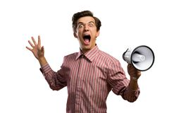 Portrait of a young man shouting using megaphone. Isolated on white background Royalty Free Stock Images