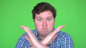 Portrait of Young Man showing stop sign, Dislike, Rejecting Gesture, Disagree Sign, Crossing hands stock video footage
