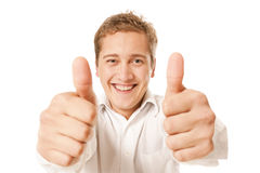 Portrait of a young man showing thumb up Royalty Free Stock Photos