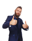 Portrait of a young man showing thumbs up. Isolated. Stylish hipster with beard shows approval, acceptance and encouragement sign. Well done symbol. Male Royalty Free Stock Images