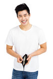 Portrait of young man showing wallet with currency note Stock Photos
