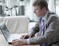 Young employee looking at computer monitor during working day Stock Images