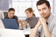 Portrait of young man sitting at meeting table Stock Photos