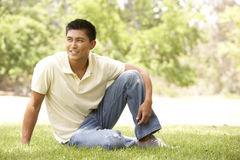 Portrait Of Young Man Sitting In Park Stock Image