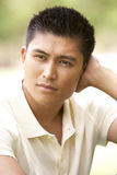 Portrait Of Young Man Sitting In Park Royalty Free Stock Images