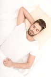 Portrait of young man sleeping Stock Images