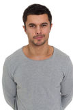 Portrait of  young man. Portrait of a young man with a sly grin Royalty Free Stock Photography