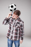 Portrait  of young man with smart phone and football ball Royalty Free Stock Image