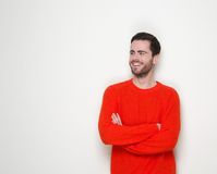 Portrait of a young man smiling with arms crossed Royalty Free Stock Image