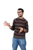 Portrait of young man smiling and gesturing Stock Photo