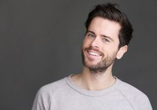 Portrait of a young man smiling on isolated gray background Royalty Free Stock Image