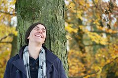 Portrait of a young man smiling outdoors Stock Photo