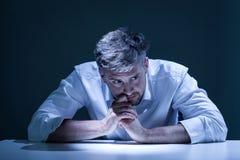 Portrait of young man in sorrow. Dark portrait of young, handsome man in sorrow Stock Image