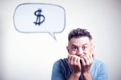 Portrait of a young man with a speech bubble dollar singe over h Stock Image