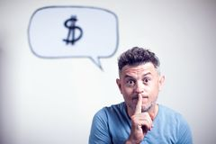 Portrait of a young man with a speech bubble dollar singe over h Stock Photography