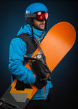 Portrait of young man in sportswear with snowboard Royalty Free Stock Photos