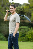 Portrait of young man standing with a gardening shovel Stock Photography