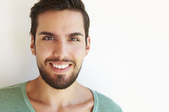 Portrait Of Young Man Standing Outdoors Against White Wall Stock Image