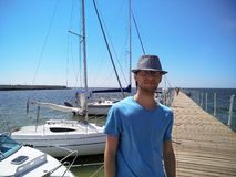 Portrait of a young man standing on the pier stock images