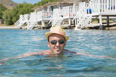 Portrait of young man with straw hat   in the sea Stock Photos