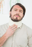 Portrait of a young man suffering from neck pain Royalty Free Stock Photo