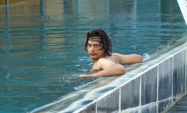 Young man in swimming pool. Portrait of young man in swimming pool Royalty Free Stock Image