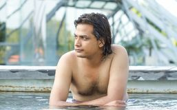 Young man in swimming pool. Portrait of young man in swimming pool Royalty Free Stock Photo