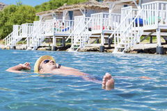Portrait of young man swimming in the sea Stock Image